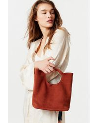 Urban Outfitters - Cutout Handheld Suede Bag - Lyst