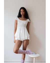 Urban Outfitters Uo Rosie Smocked Tiered Ruffle Romper - White
