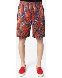Needles Shorts in velour - Rosso