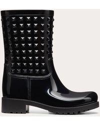 Valentino - Rockstud Patent Rainboots - Lyst