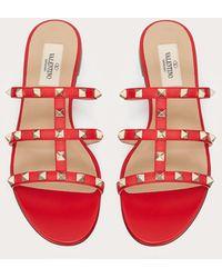 Valentino Garavani Valentino garavani sandalias de pala planas rockstud de piel de becerro - Rojo
