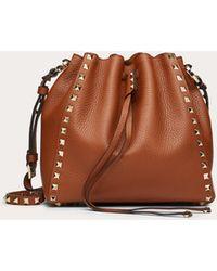 Valentino Garavani Small Rockstud Grainy Calfskin Bucket Bag - Brown