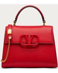 Valentino Garavani Vsling Small Top Handle Bag In Grained Calfskin - Red