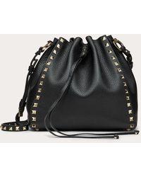 Valentino Garavani Small Rockstud Grainy Calfskin Bucket Bag - Black