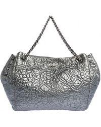 Chanel Patent Leather Handbag - Metallic