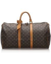 Louis Vuitton Borsa da viaggio in tela marrone Keepall