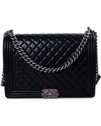 1923644e6a9c Lyst - Chanel Quilted Boy Wallet On Chain Black in Metallic