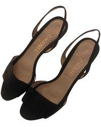 Chanel Sandalias en cuero negro