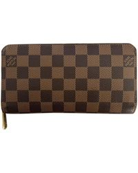 Louis Vuitton Portefeuilles Zippy en Toile Marron