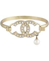 Chanel - Cc Gold Metal Bracelets - Lyst