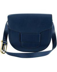 5fc418a17938 Tory Burch Kerrington Striped Vinyl Crossbody Bag in Blue - Lyst
