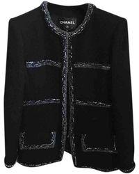 Chanel Chaqueta en tweed negro