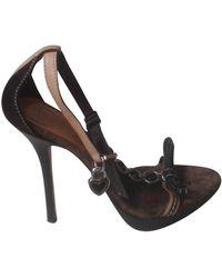 Dior Sandali in pelle di vitello effetto cavallino marrone