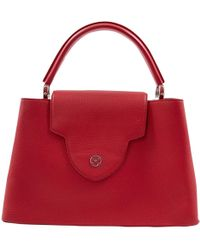 Louis Vuitton - Pre-owned Capucines Red Leather Handbags - Lyst