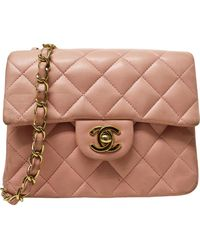 Chanel Bolsa de mano en cuero rosa Timeless/Classique