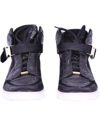 249adeee5a31 Louis Vuitton - Pre-owned Black Python Trainers - Lyst