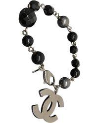 Chanel - Black Metal Bracelets - Lyst