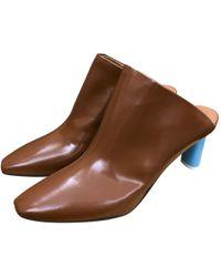 Vetements - Mules en cuir verni - Lyst