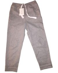 Acne Studios Pantalones en lana gris