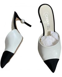 Chanel Leather Mules - White