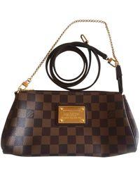 Louis Vuitton Borsa a mano in tela marrone Eva