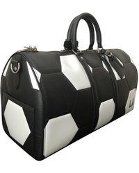 Louis Vuitton Bolsos en cuero negro Keepall