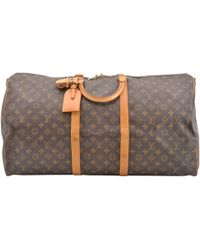Louis Vuitton - Pre-owned Vintage Keepall Brown Cloth Travel Bags - Lyst