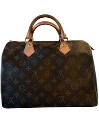 Louis Vuitton Bolsa de mano en lona marrón Speedy