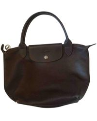 Longchamp - Pre-owned Pliage Leather Handbag - Lyst