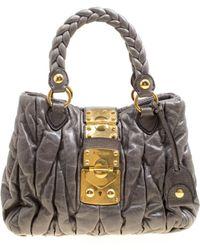 8114a6954ed Lyst - Miu Miu Matelassé Leather Handbag in Natural
