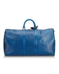 e3f4f79fa011 Louis Vuitton - Pre-owned Vintage Keepall Blue Leather Travel Bags - Lyst