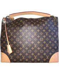 ae9ba9980bca Louis Vuitton - Berri Brown Cloth Handbag - Lyst