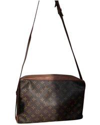 Louis Vuitton Leinen Handtaschen - Braun