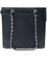 10f482a0cfe6f4 Chanel - Petite Shopping Tote Black Leather Handbag - Lyst