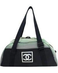 Chanel - Pre-owned Black Cloth Travel Bags - Lyst