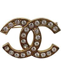 Chanel Broche CC en Metal Amarillo
