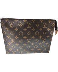 Louis Vuitton Multi Pochette Accessoires Leinen Clutches - Braun