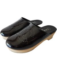 Chanel Lackleder Clogs - Schwarz