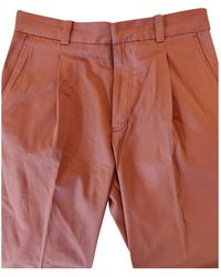 Acne Studios Pantaloni in cotone rosa