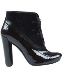 2bfe348dc3cc Louis Vuitton - Pre-owned Black Patent Leather Ankle Boots - Lyst