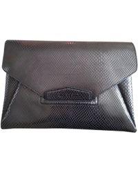 ecfe346b8514 Givenchy Antigona Printed Faux Leather Clutch in Black - Lyst
