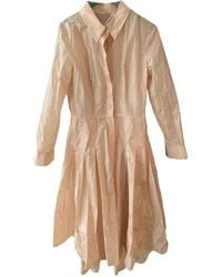 Dior Pink Silk Trench Coats