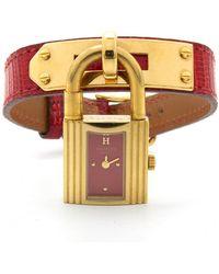 Hermès Reloj en chapado en oro rojo Kelly