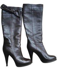 Dior Botas en cuero marrón