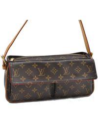 Louis Vuitton - Pre-owned Viva Cité Brown Cloth Handbags - Lyst