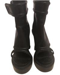 Givenchy Leder Pantoffeln - Schwarz