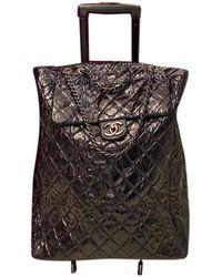 Chanel Sac de voyage en Cuir Noir