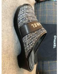 Chanel Sabots en Cuir Noir