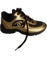 Chanel Gold Leather Trainers - Metallic