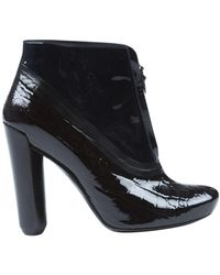 Louis Vuitton \n Black Patent Leather Ankle Boots